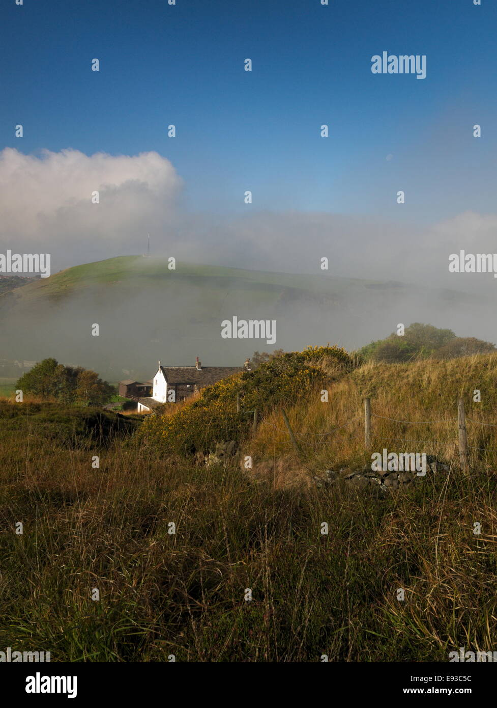 Autumn mist below Knowl Top, Saddleworth with moon - Stock Image
