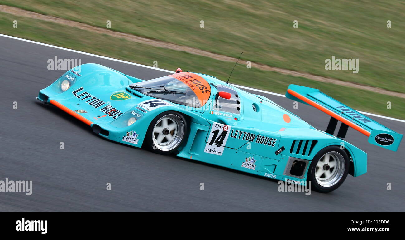 Porsche 962 Group C endurance Le Mans prototype in Leyton House livery racing at the 2014 Silverstone Classic in Stock Photo