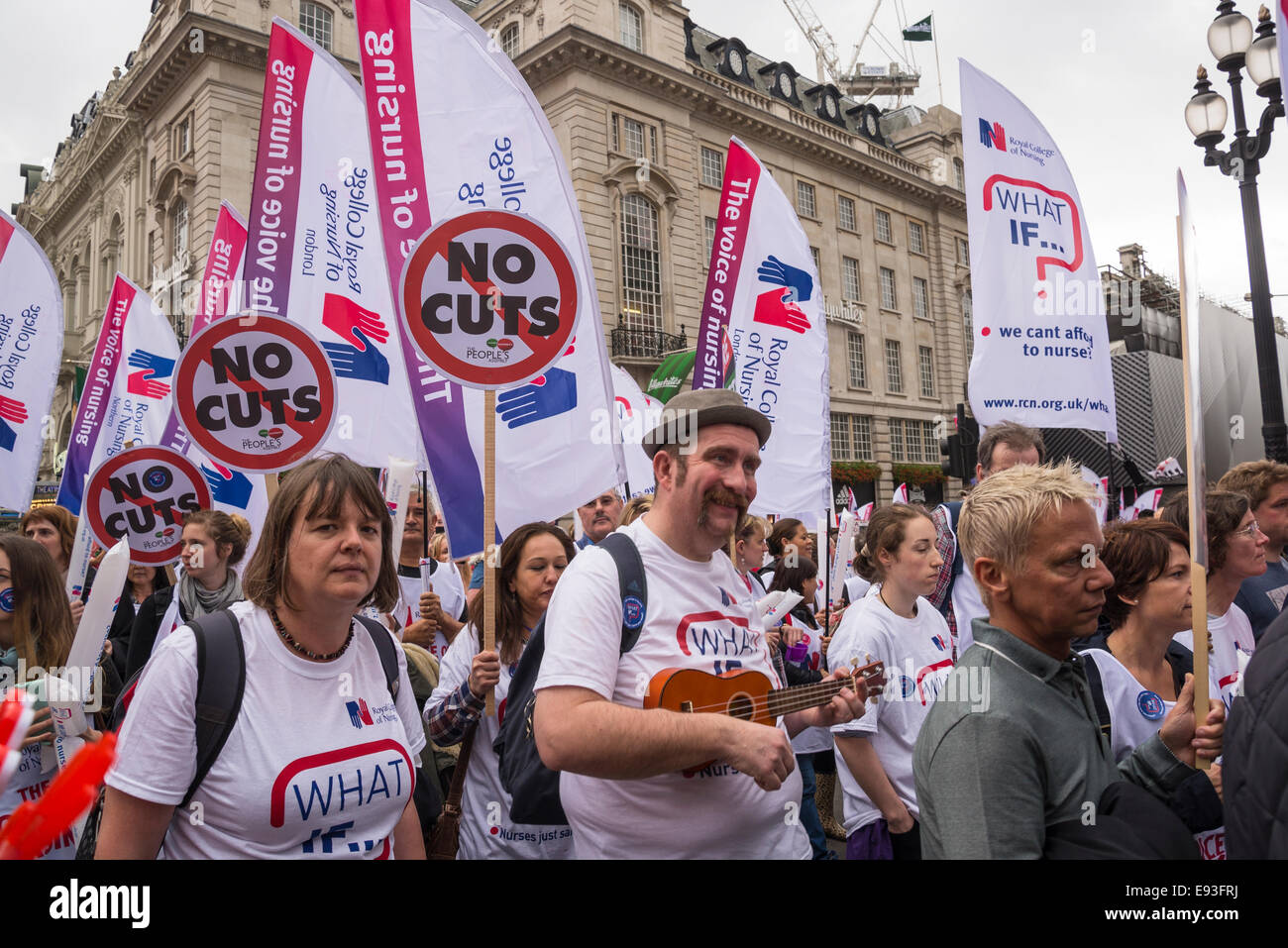 Nurses carrying Royal College of Nursing flags and No Cuts placards, Britain Needs a Pay Rise march, London, 18 - Stock Image