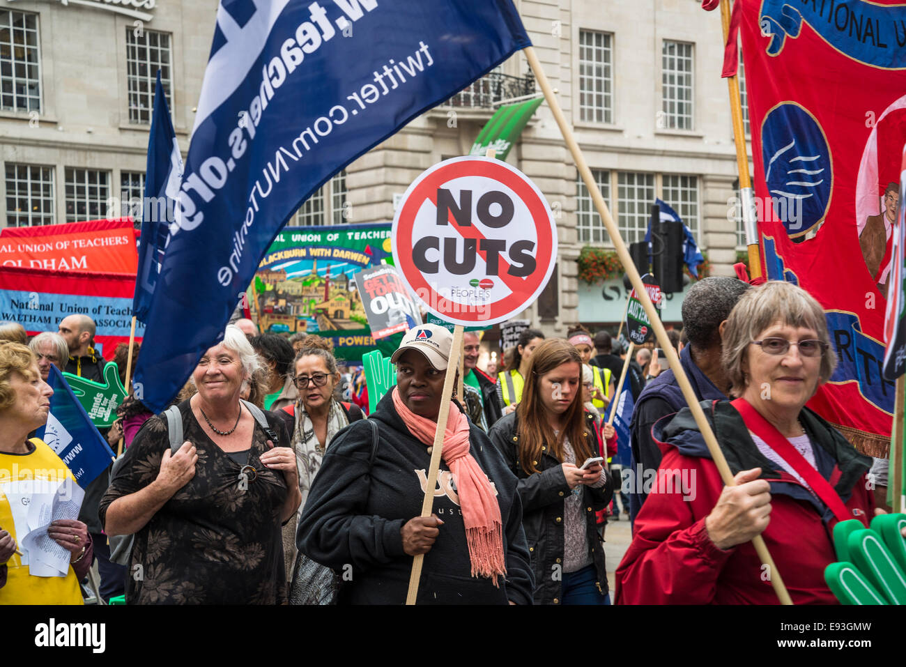 Woman with No Cuts placard. Britain Needs a Pay Rise march, London, 18 October 2014, UK Credit:  Bjanka Kadic/Alamy - Stock Image