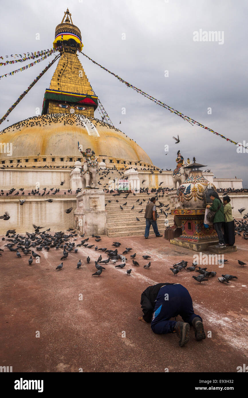 Buddhists in prayer at dawn, Boudhanath, Kathmandu, Nepal, Asia - Stock Image