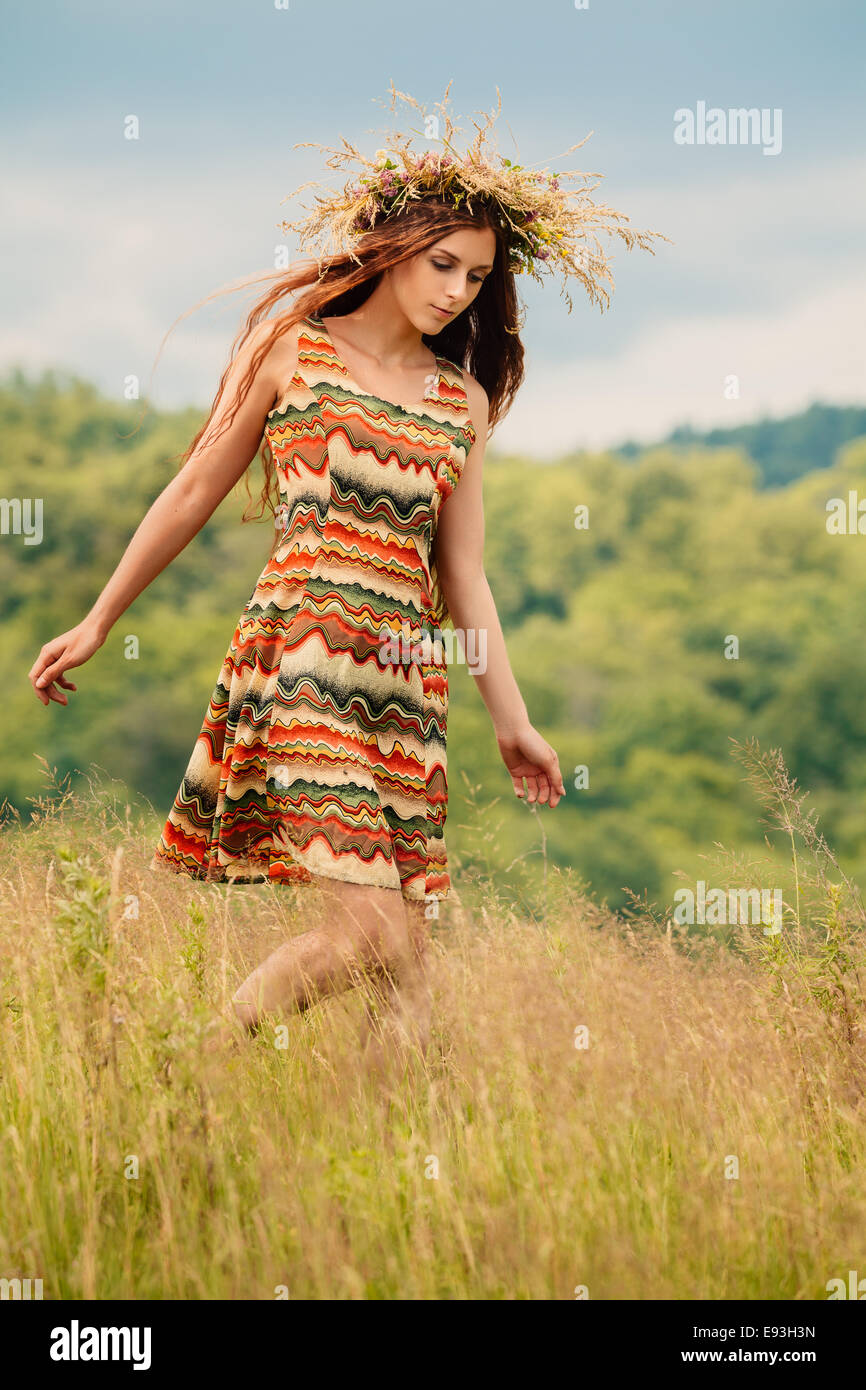 Woman walking in field Stock Photo