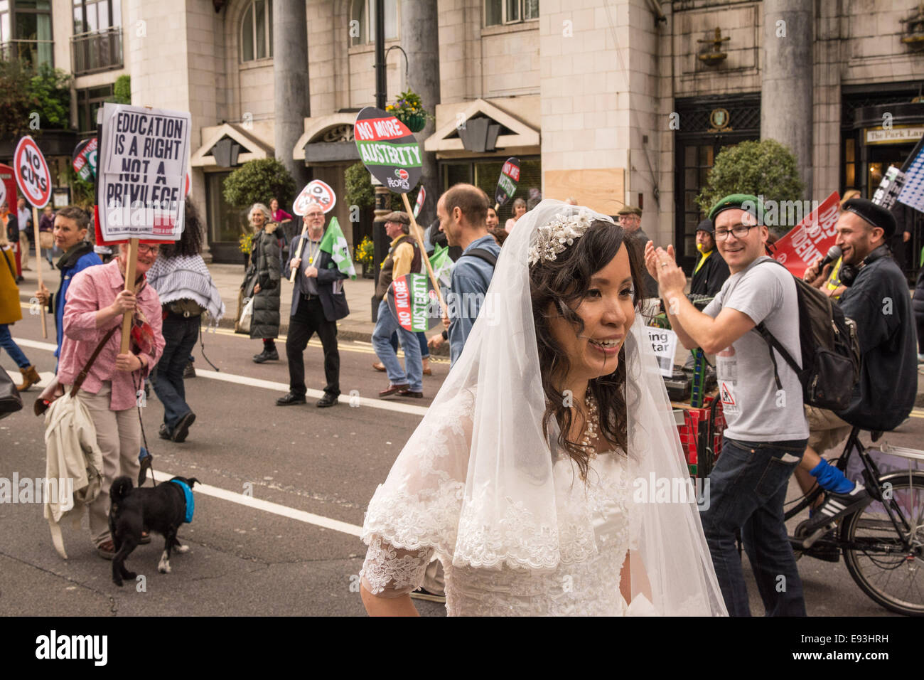 London, UK, 18th October 2014. A new bride gets caught up among crowds during the 'Britain needs a pay rise' - Stock Image