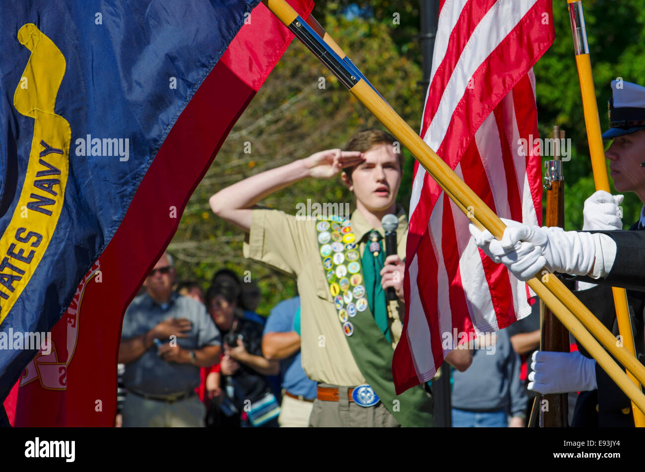 An Eagle Scout delivers the Pledge of Allegiance as a Color Guard presents the American, Navy and Marine Flags Stock Photo