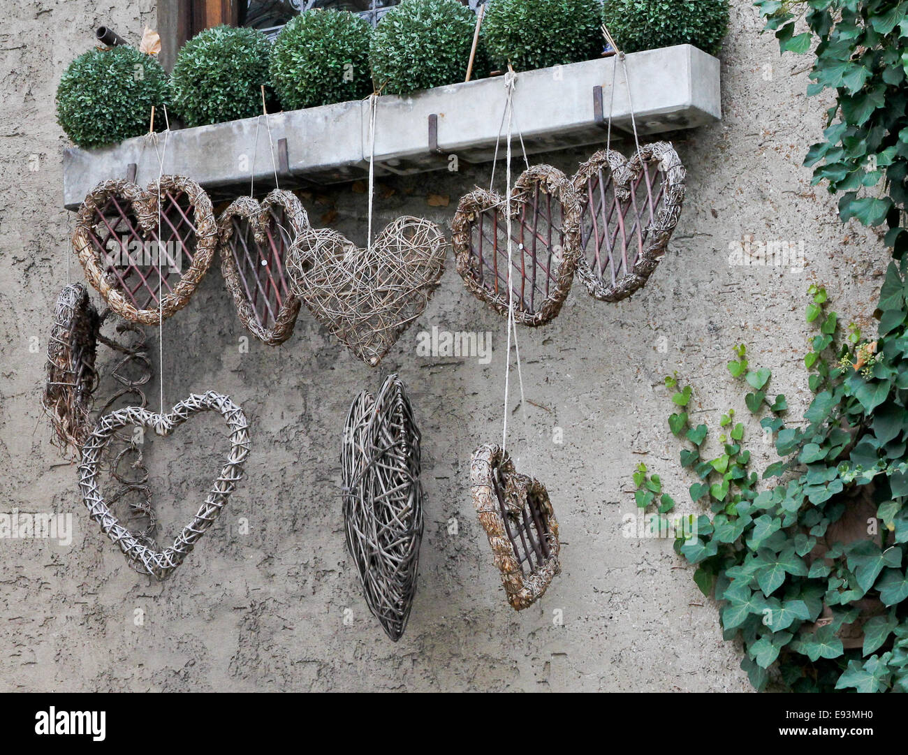 Woven Hearts, Hanging from a window Box - Stock Image