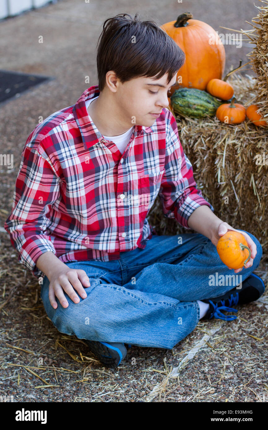 Boy with Autism and Down's Syndrome chooses a Pumpkin - Stock Image