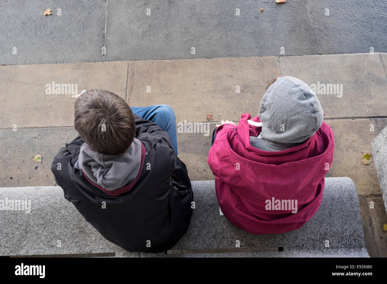 Aerial Shot Of Two People Sitting On A Bench