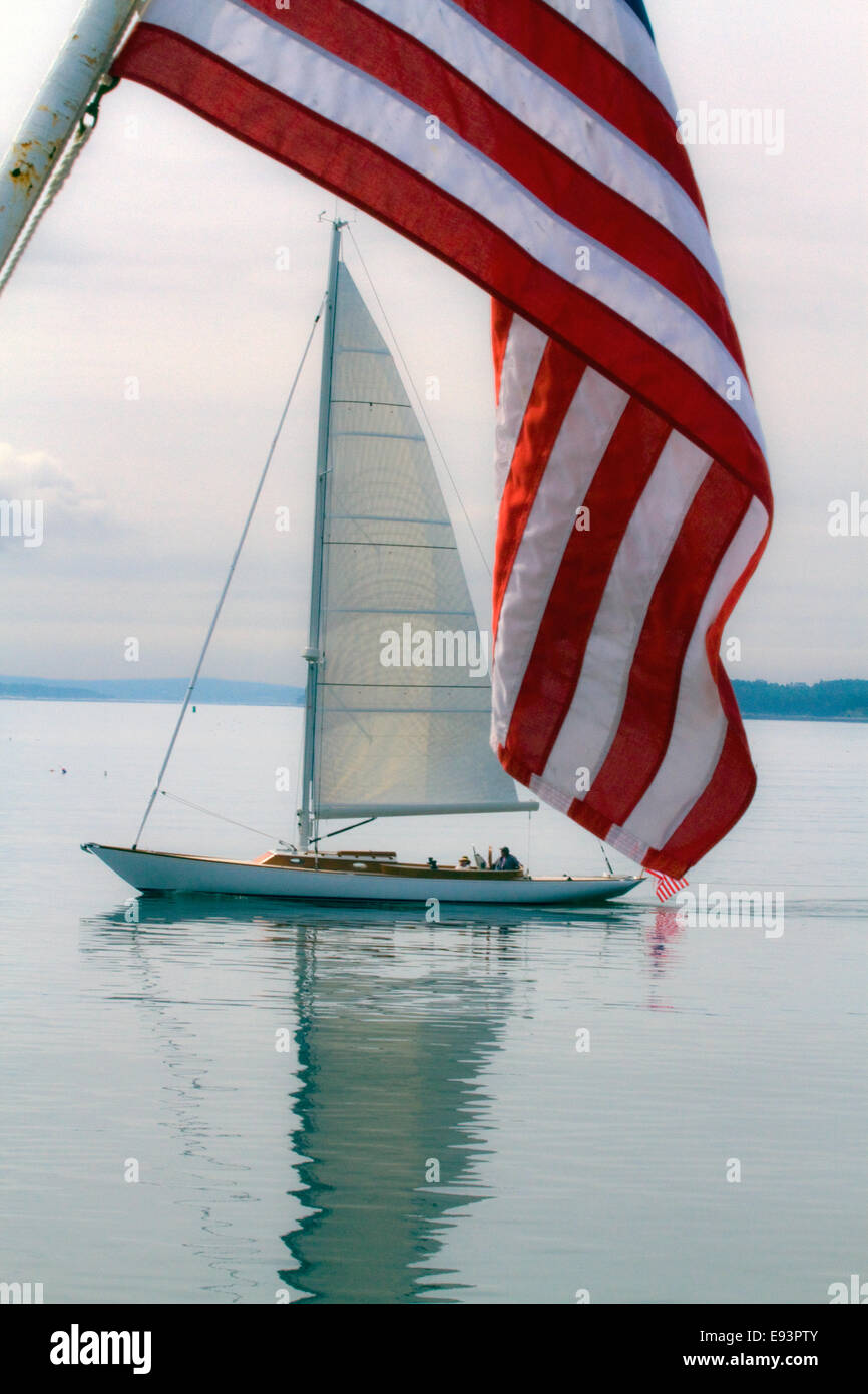 Sail Boat framed by American Flag - Stock Image