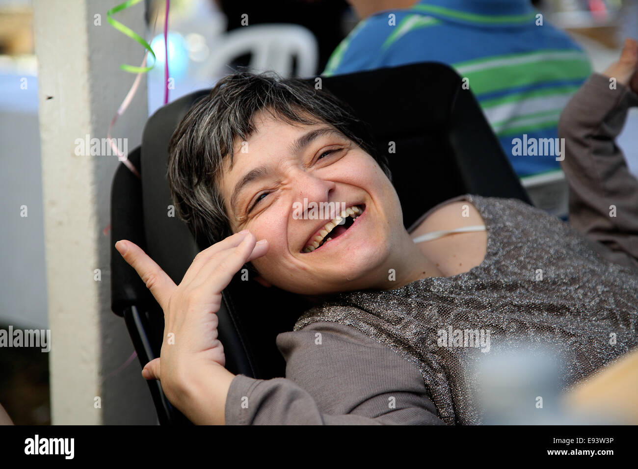 Cyprus. 18th Oct, 2014. A woman with disabilites smiling in the yard of Presidential for Radiomarathonios. Radiomarathonios - Stock Image