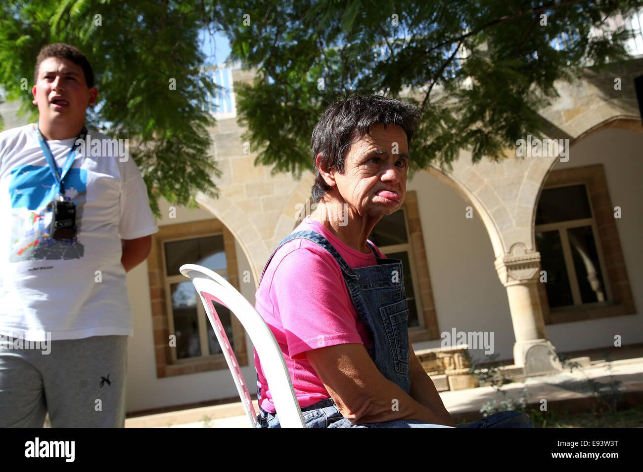 Cyprus. 18th Oct, 2014. Kid with disabilites sitting in the yard of Presidential for Radiomarathonios. Radiomarathonios - Stock Image
