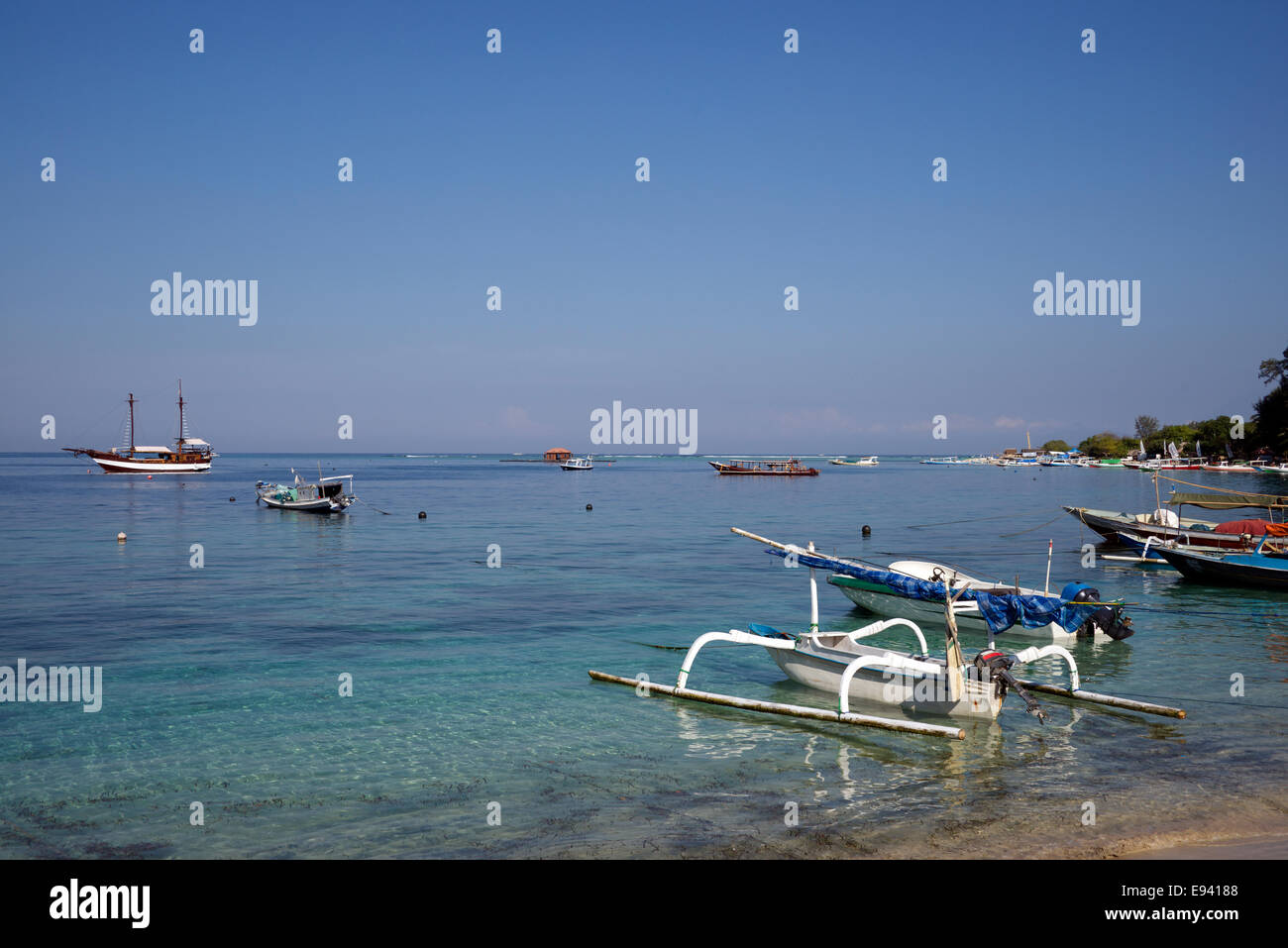 Moored outrigger boats Gili Air Lombok Indonesia - Stock Image