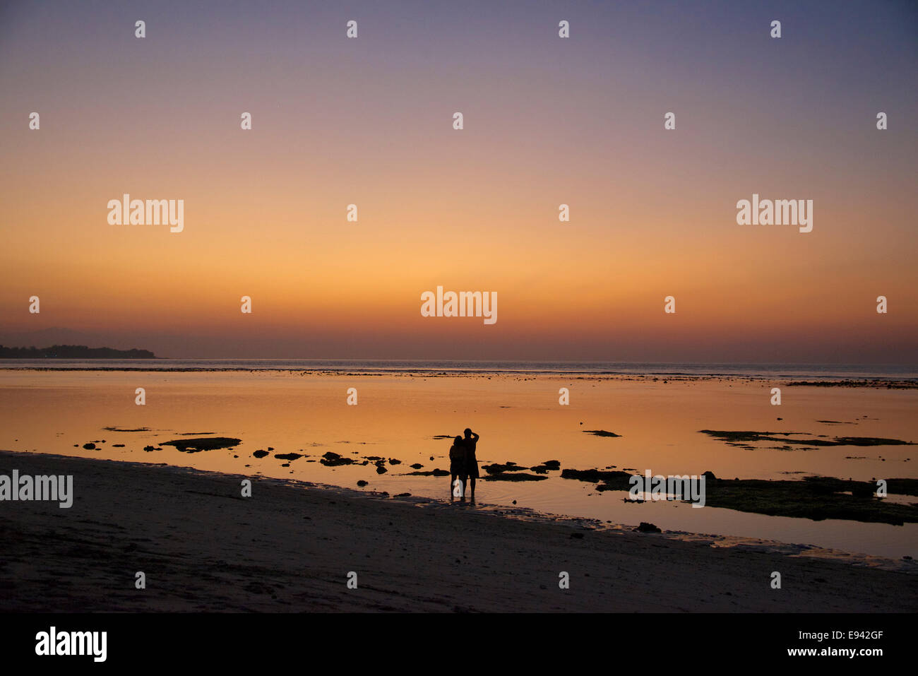 Twilight with couple at foreshore Gili Air Lombok Indonesia - Stock Image