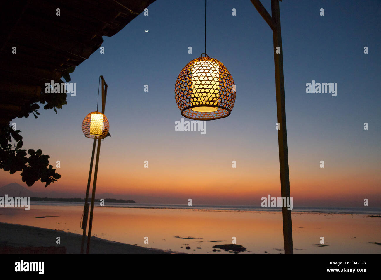 Twilight with hanging lanterns Gili Air Lombok Indonesia - Stock Image