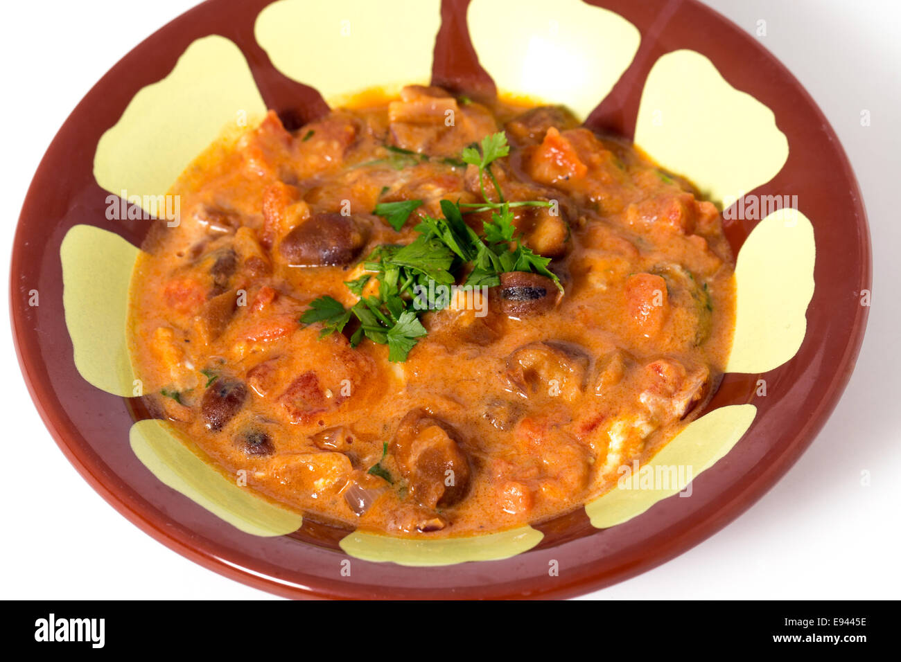Egyptian foul medammes, a staple of the country's diet, made from fava (broad) beans, tomato, onion, garlic - Stock Image