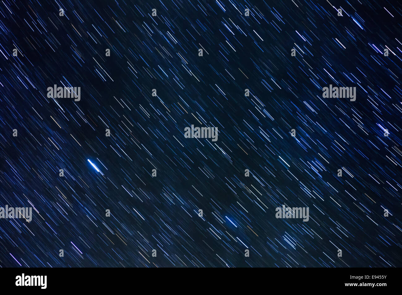 Stars of the Milky Way moving on the night sky during long exposure. Taken with 300mm lens and two minute exposure. - Stock Image