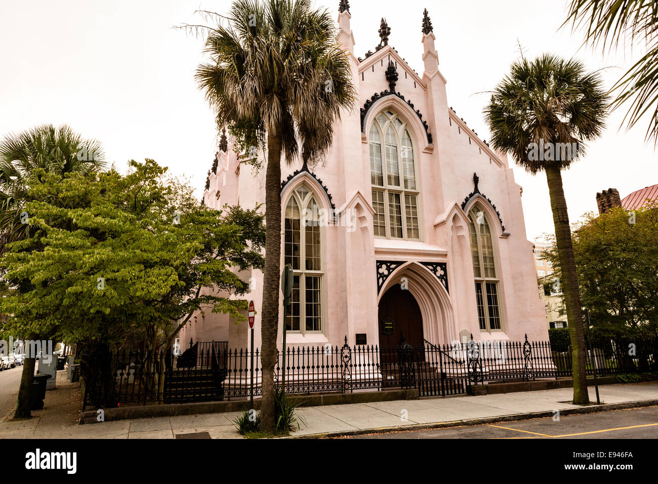 The pink French Huguenot Church in the French Quarter along Church Street in historic Charleston, SC. - Stock Image