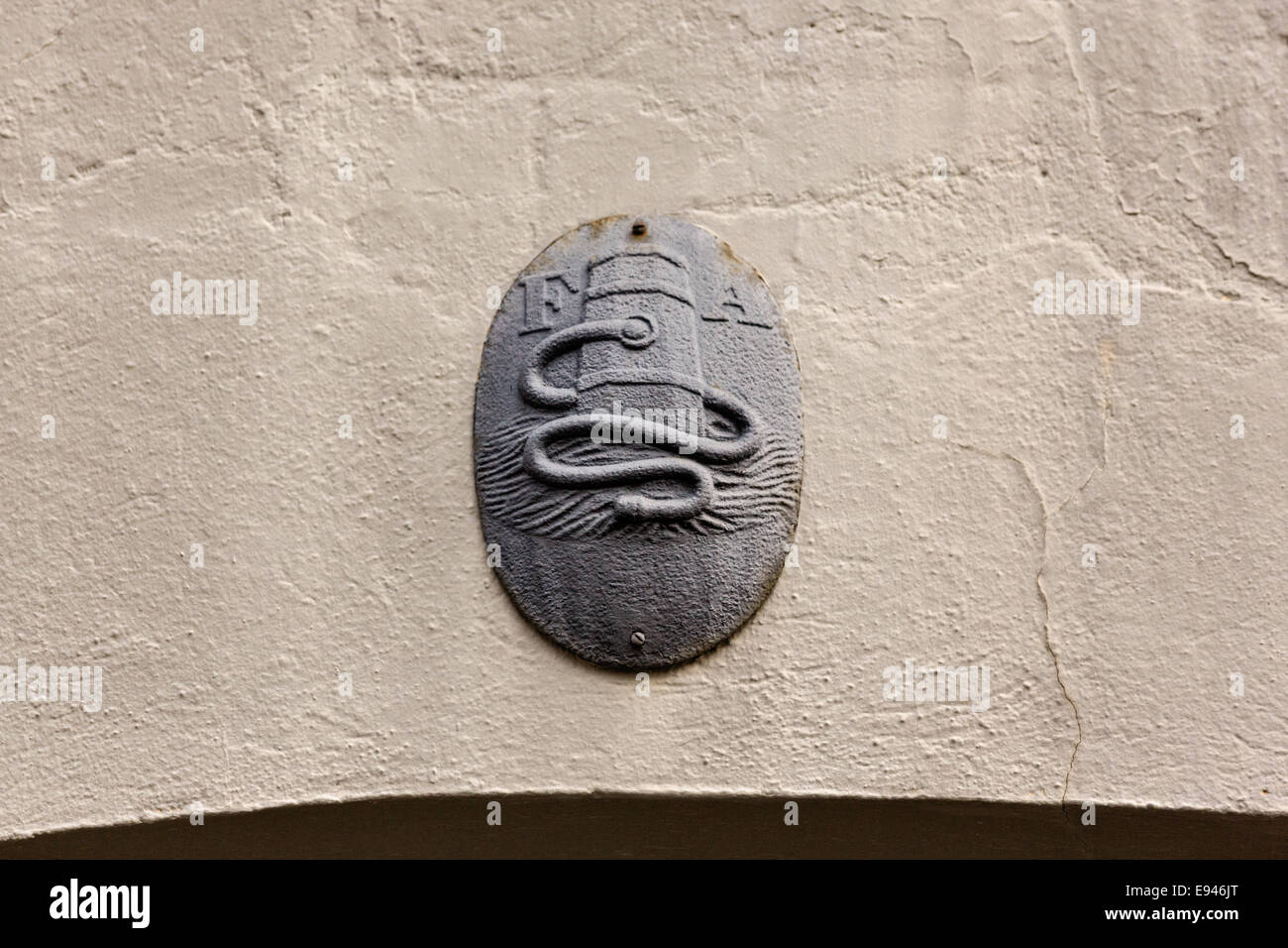 A Fire Insurance mark or plaque on a home in the French Quarter along Queen Street in historic Charleston, SC. Stock Photo