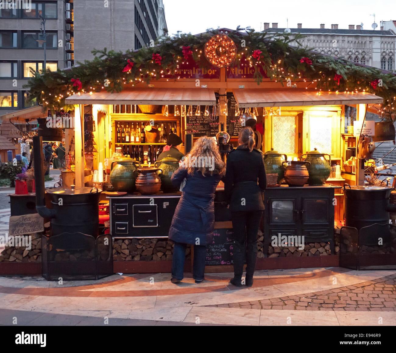 Mulled Wine Christmas Market.Tourists Enjoy The Traditional Christmas Market At A Mulled