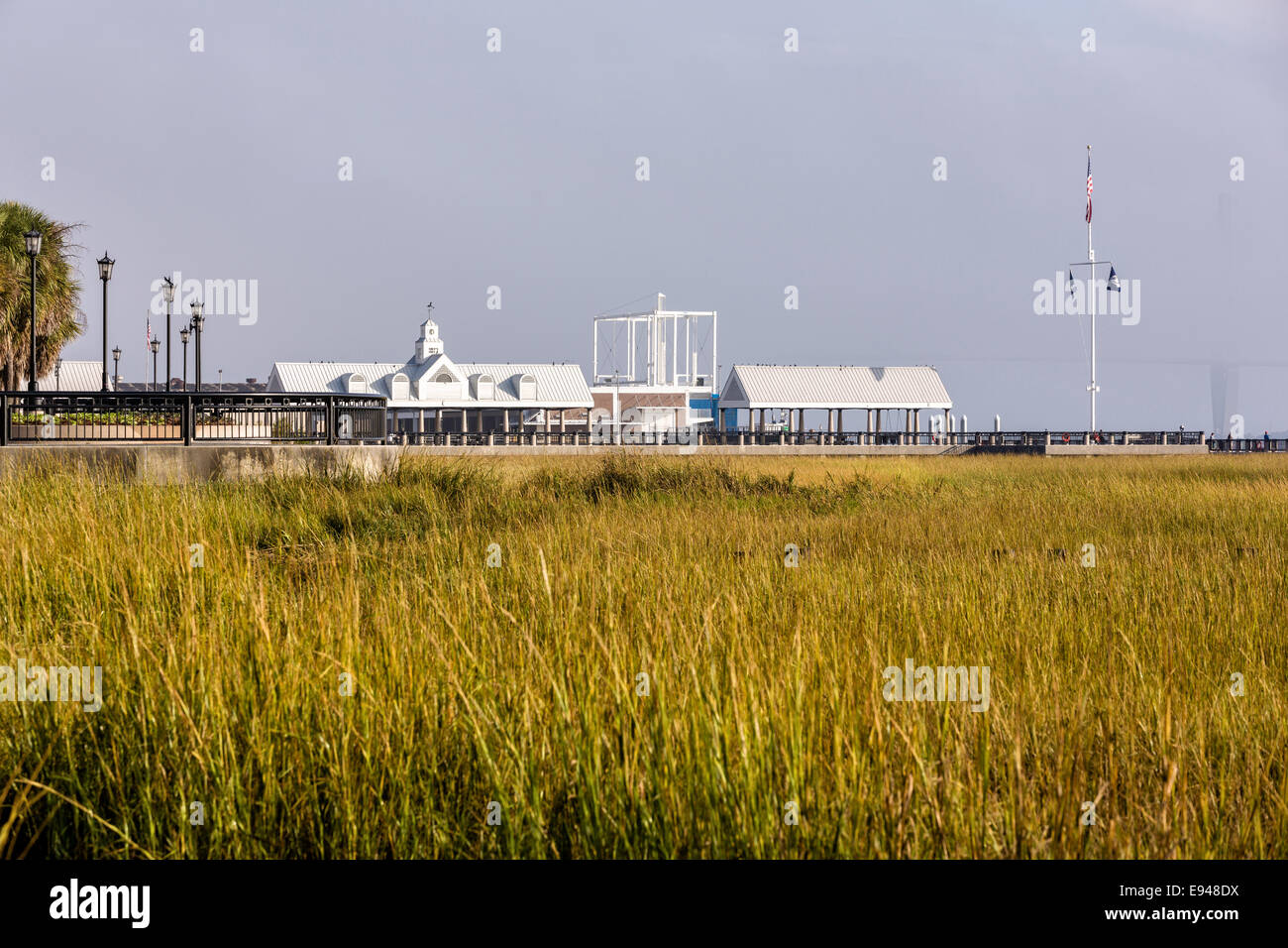 View of the marsh and pier shelters along Waterfront Park on a foggy morning in historic Charleston, SC. - Stock Image