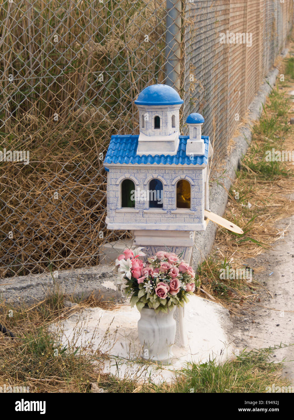 Greek orthodox roadside memorial miniature chapel, put up where an accident has occurred, Samos Greece - Stock Image