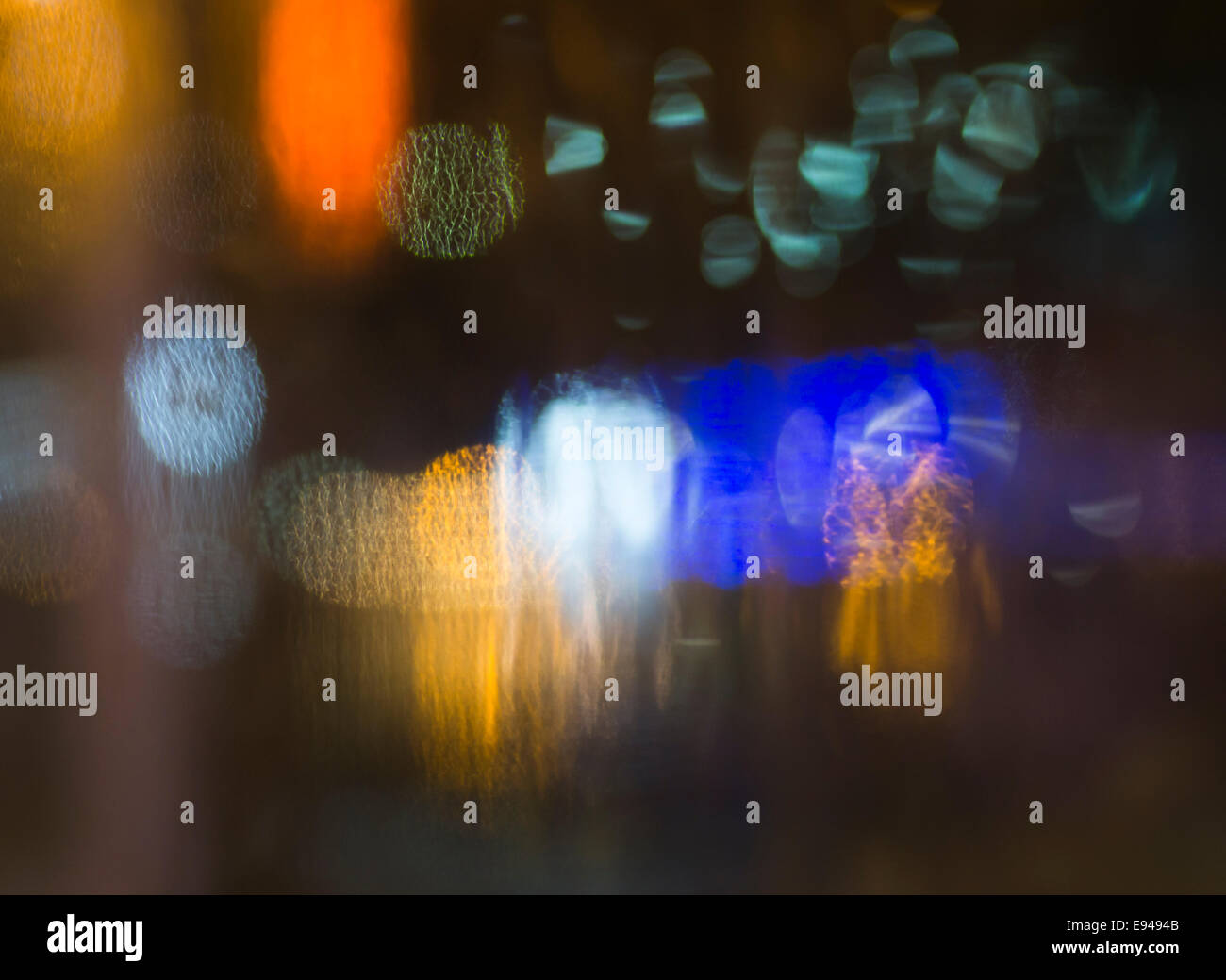 Abstract coloured light impressions of night life in the harbour of  Pythagorion on Samos island in Greece Stock Photo