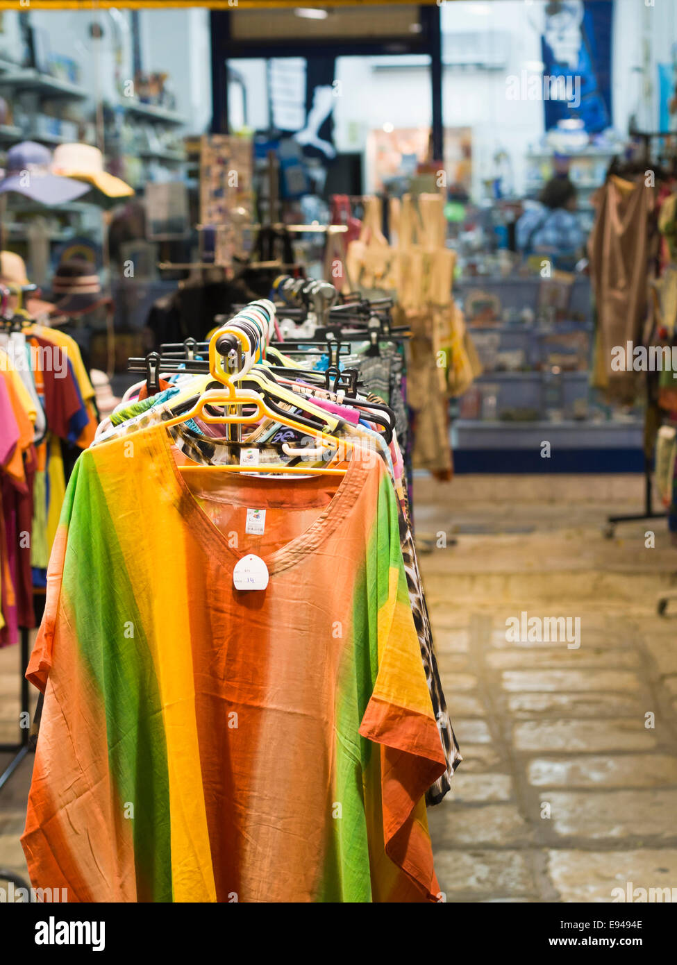 summer beach clothes and souvenirs for sale in an island holiday resort in Pythagorion, Samos Greece Stock Photo