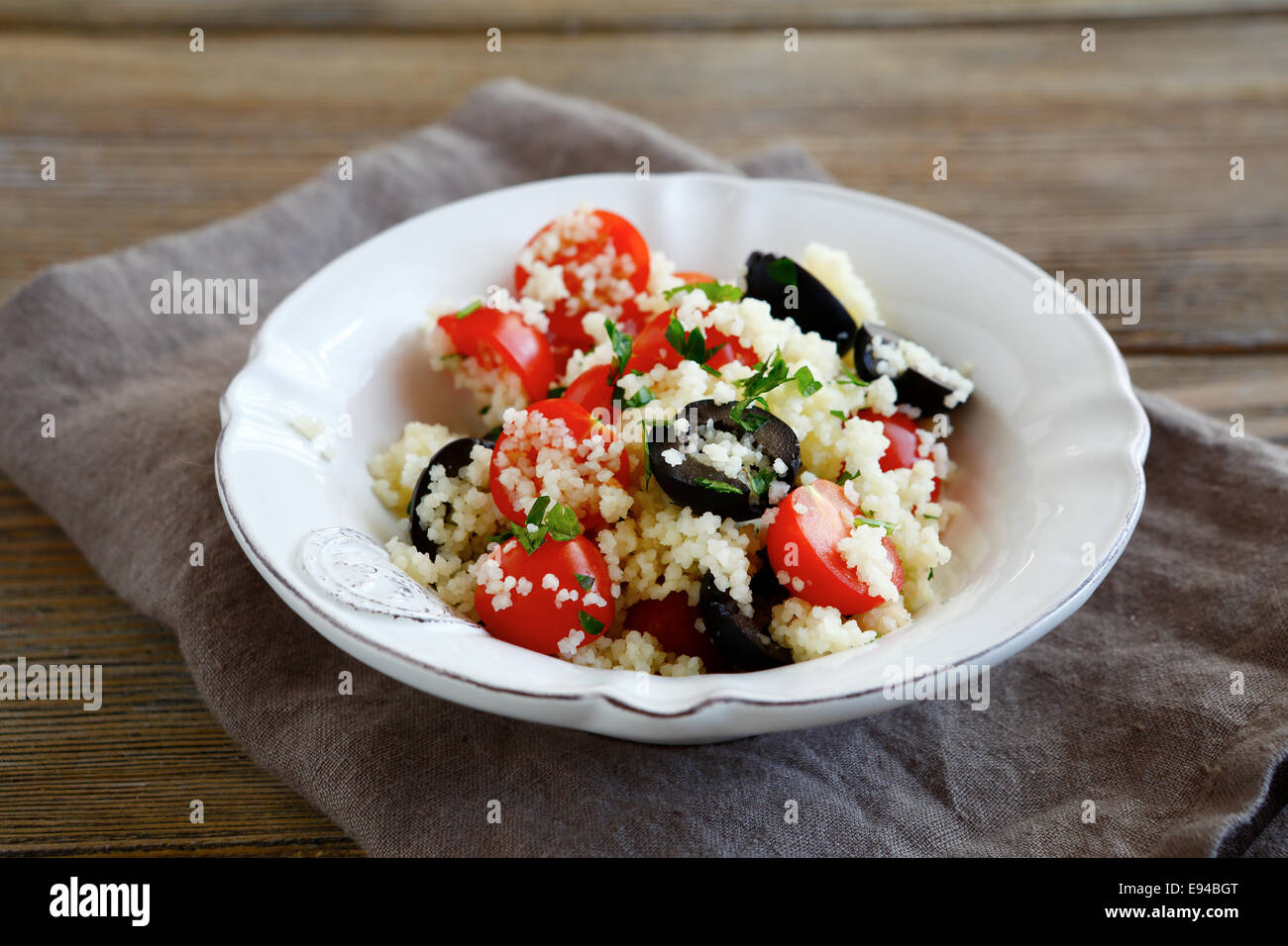 Light salad with couscous and vegetables, food - Stock Image