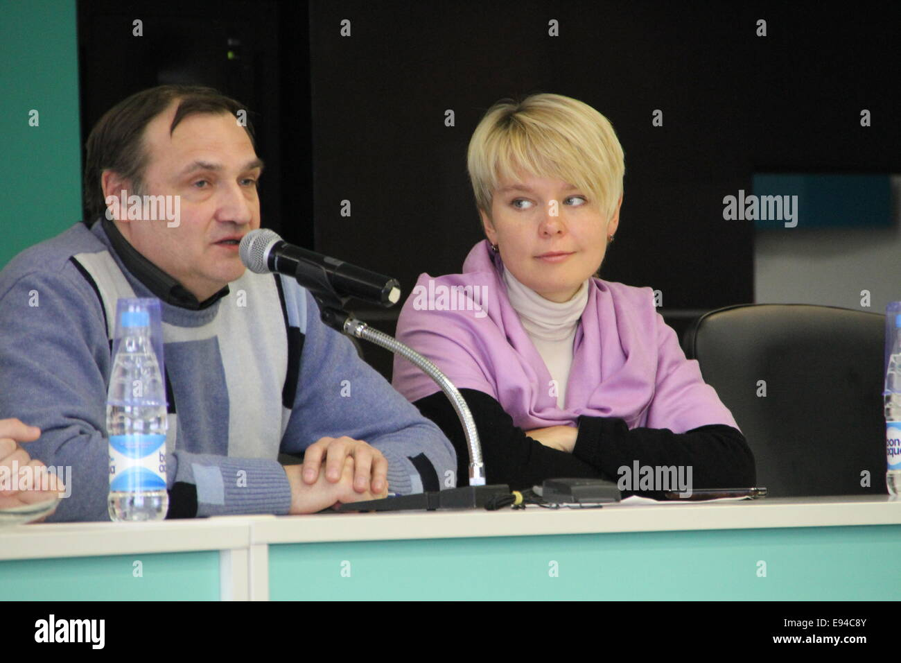 Moscow, Russia - February 11, 2012. Expert Andrei Buzin and policies Evgeniya Chirikova. Conference on the set of - Stock Image