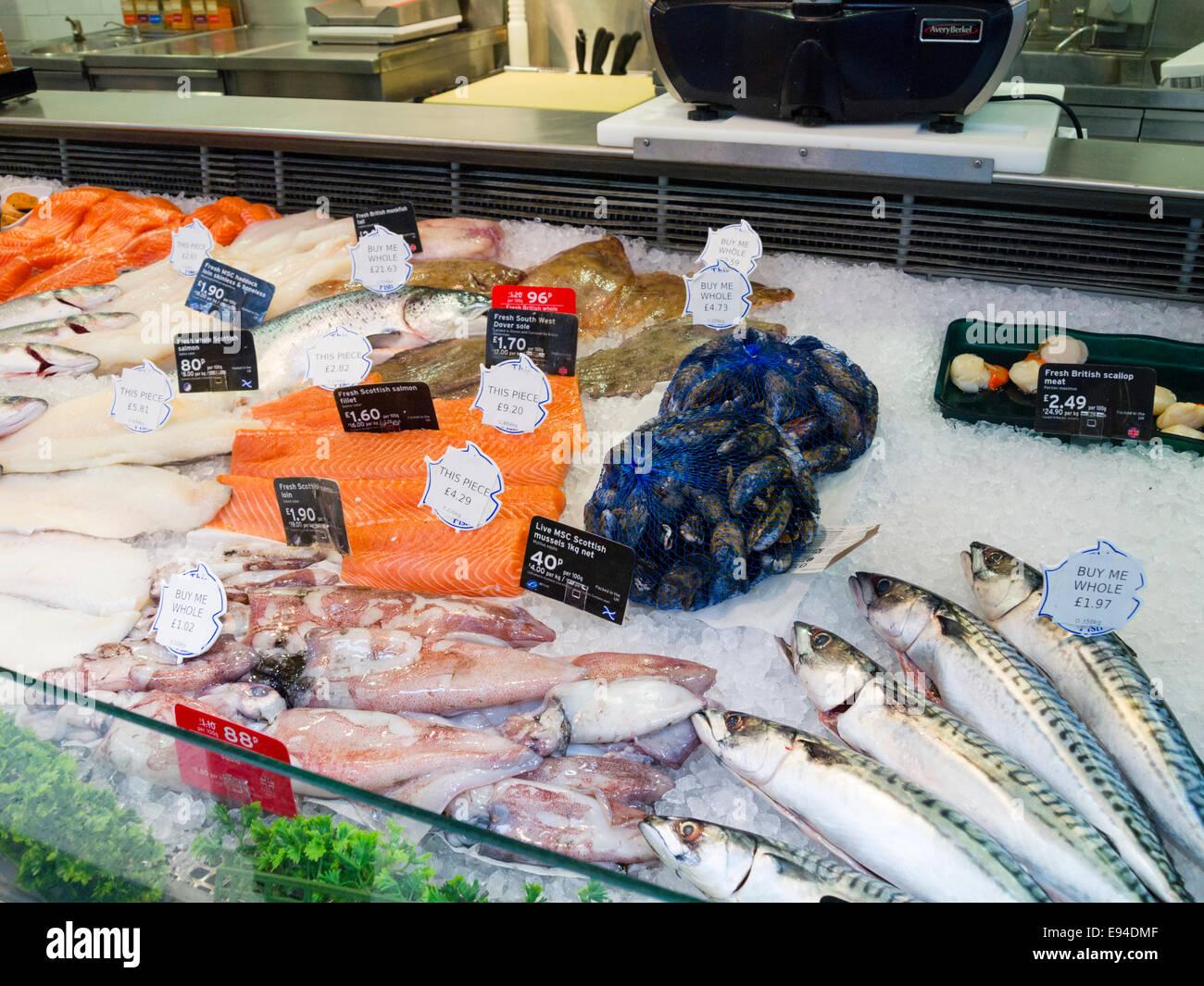 Sainsburys supermarket fish counter, England, UK - Stock Image