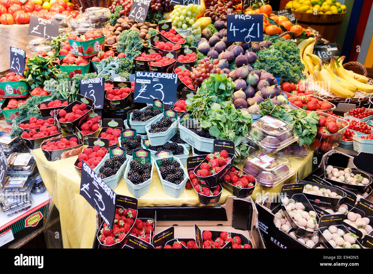Selection of different fruit on a market stall, Borough Market, London, England, UK - Stock Image