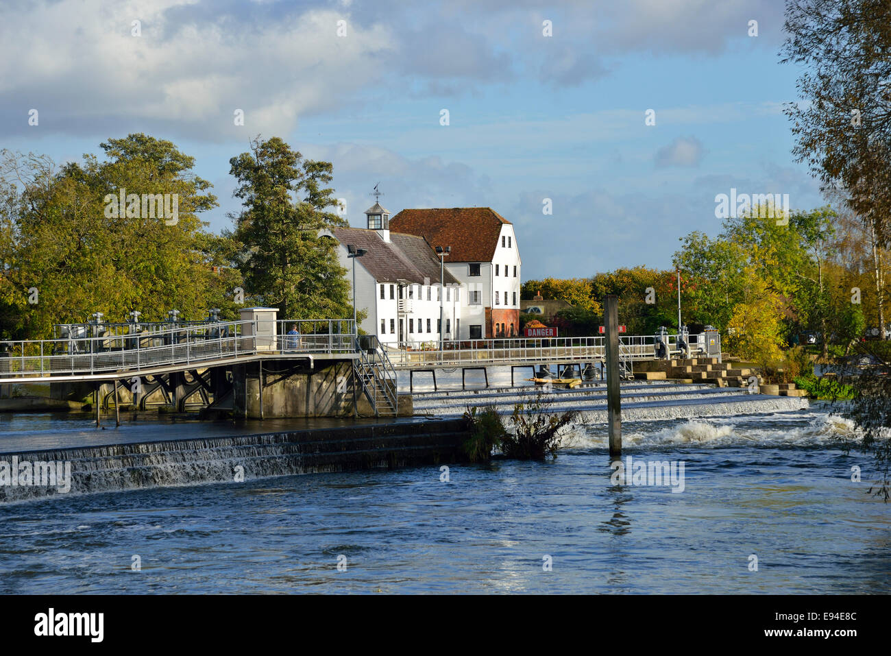 Looking across to the historic Hambleden Mill and weir on the River Thames, Mill End,  Hambledon, Buckinghamshire,England - Stock Image