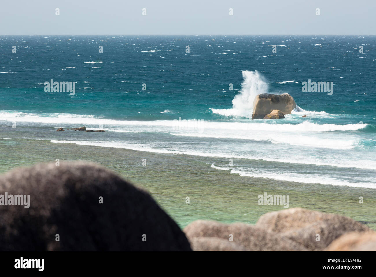 High angle view of the famous Anse Source D'Argent lagoon in La Digue, Seychelles with tall waves hitting the granite Stock Photo