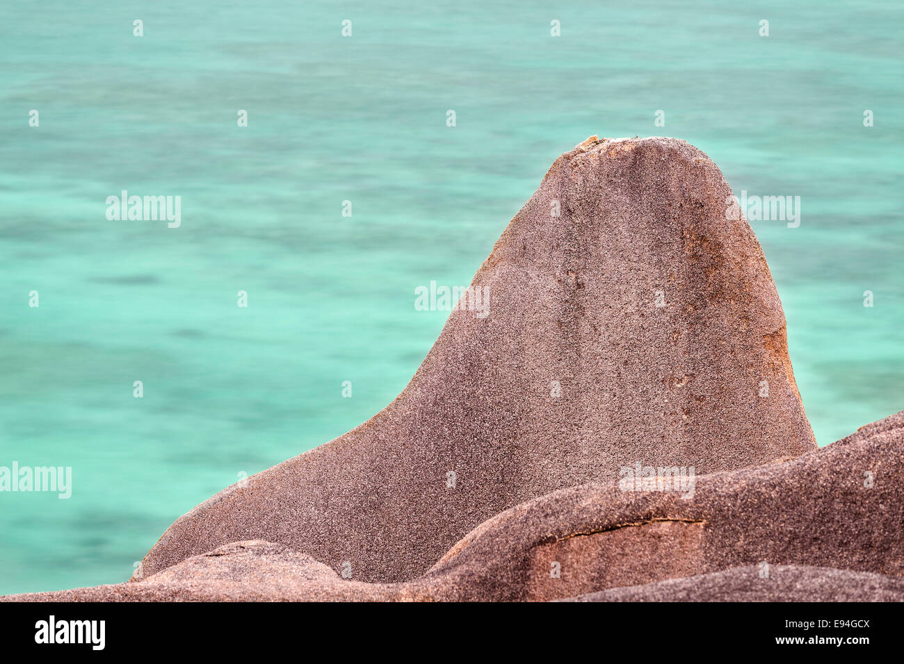 Long exposure view of a granite rock at the famous Anse Source D'Argent in La Digue, Seychelles Stock Photo