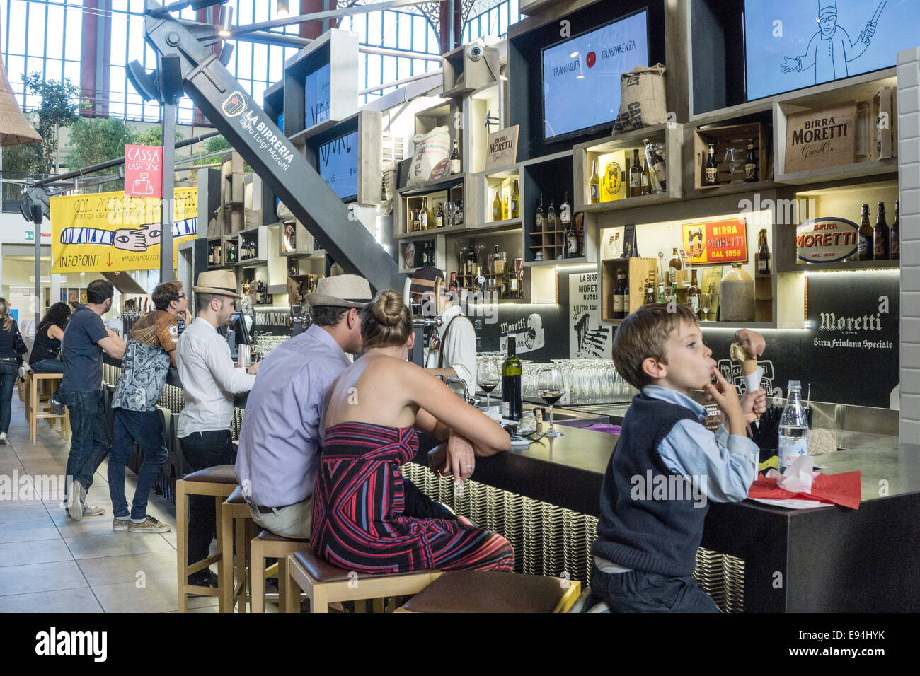 bar on top floor of cast iron & glass Central Market Mercato Centrale with diverse patrons enjoying an afternoon - Stock Image