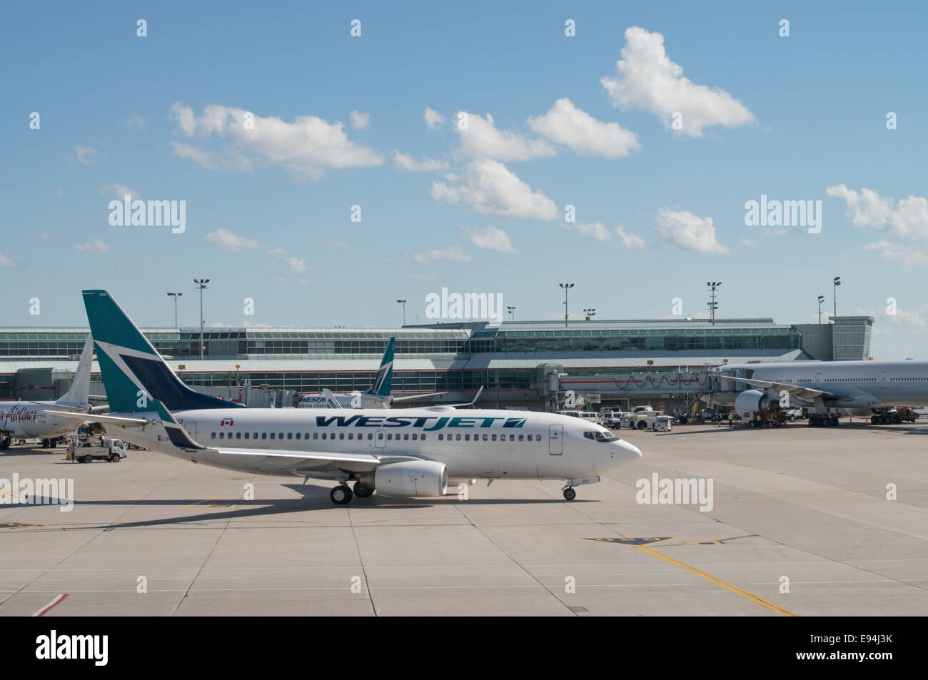 West Jet plane on the apron at Toronto Pearson International airport, Ontario, Canada - Stock Image