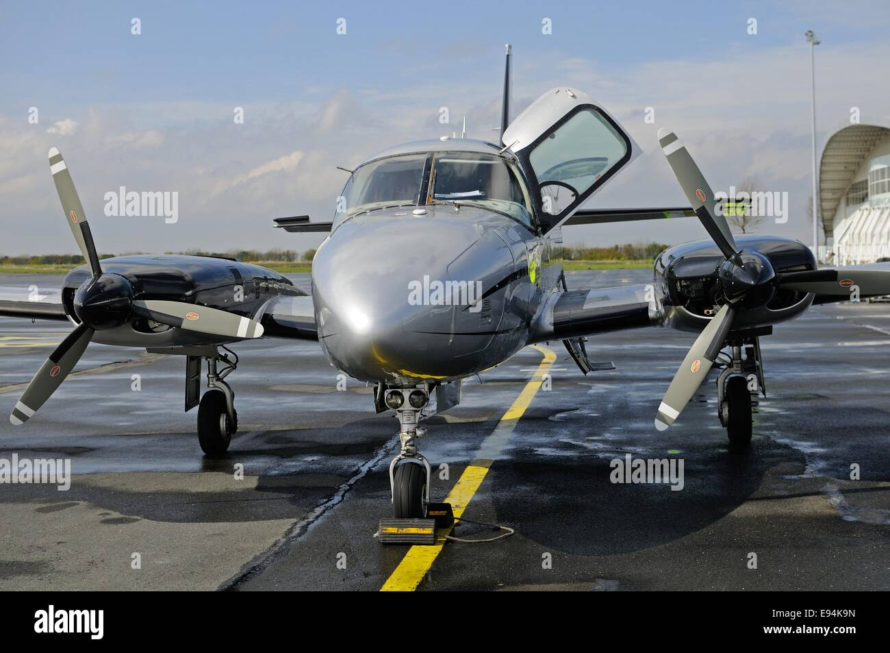 Front view of a Piper Chieftain twin-engined aircraft sitting on a tarmac air strip - Stock Image