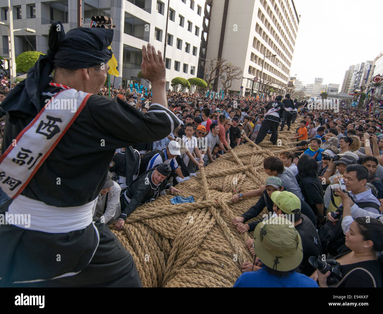 Naha City, Japan. 19th Oct, 2014. Conducting the crowd to pull at the world's biggest tug of war. Naha City, Okinawa, Stock Photo