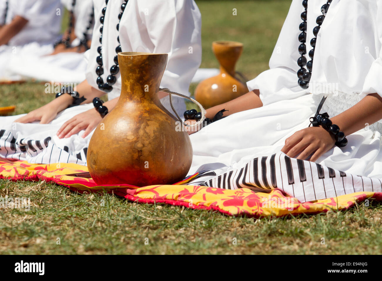 Hawaiian dancers sitting next to Hawaiian gourds - Stock Image