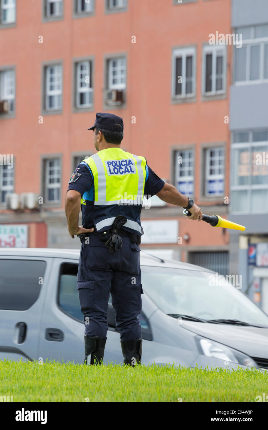 Spanish Policeman directing traffic in Las Palmas, the capital of Gran Canaria, Canary Islands, Spain - Stock Image