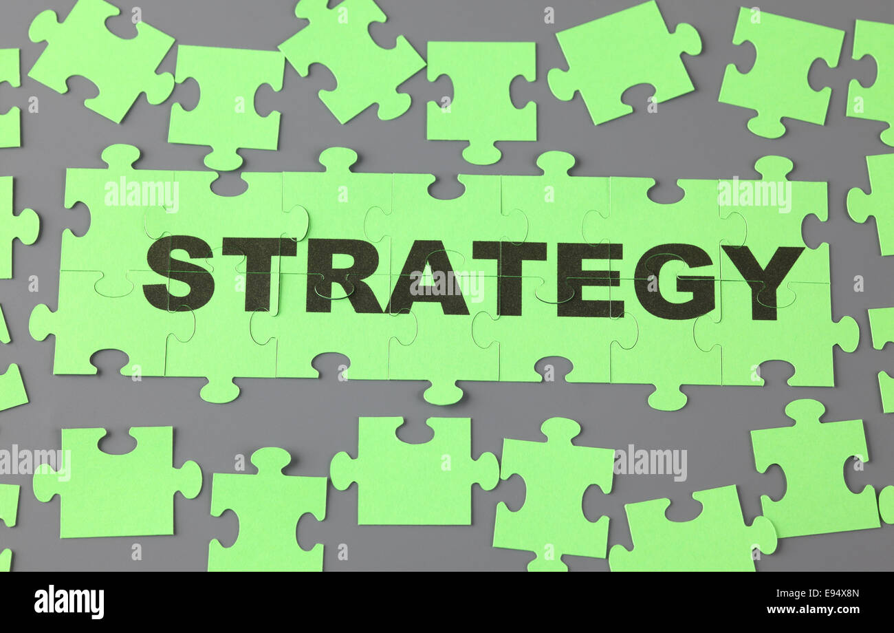 Jigsaw puzzle with word 'Strategy'. - Stock Image