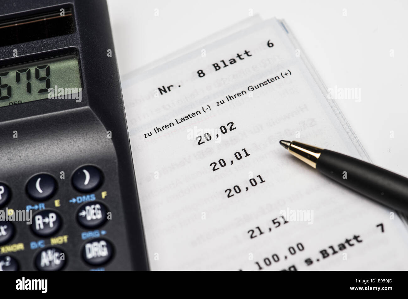 Calculator is located on a bank statement Stock Photo