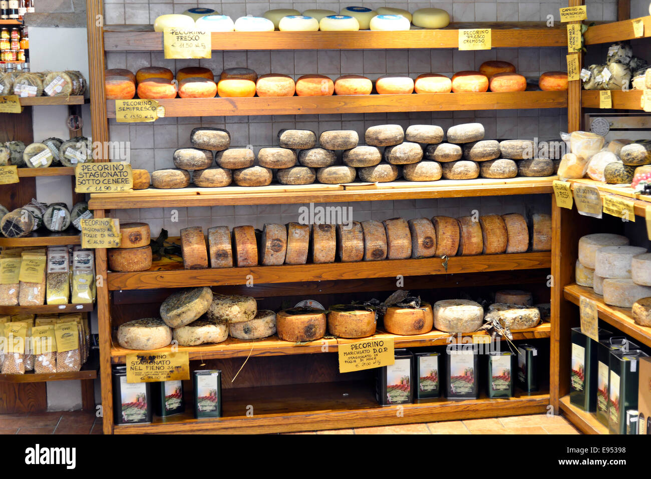Pecorino cheese on sale in a specialty shop, Pienza, Siena Province, Tuscany, Italy - Stock Image