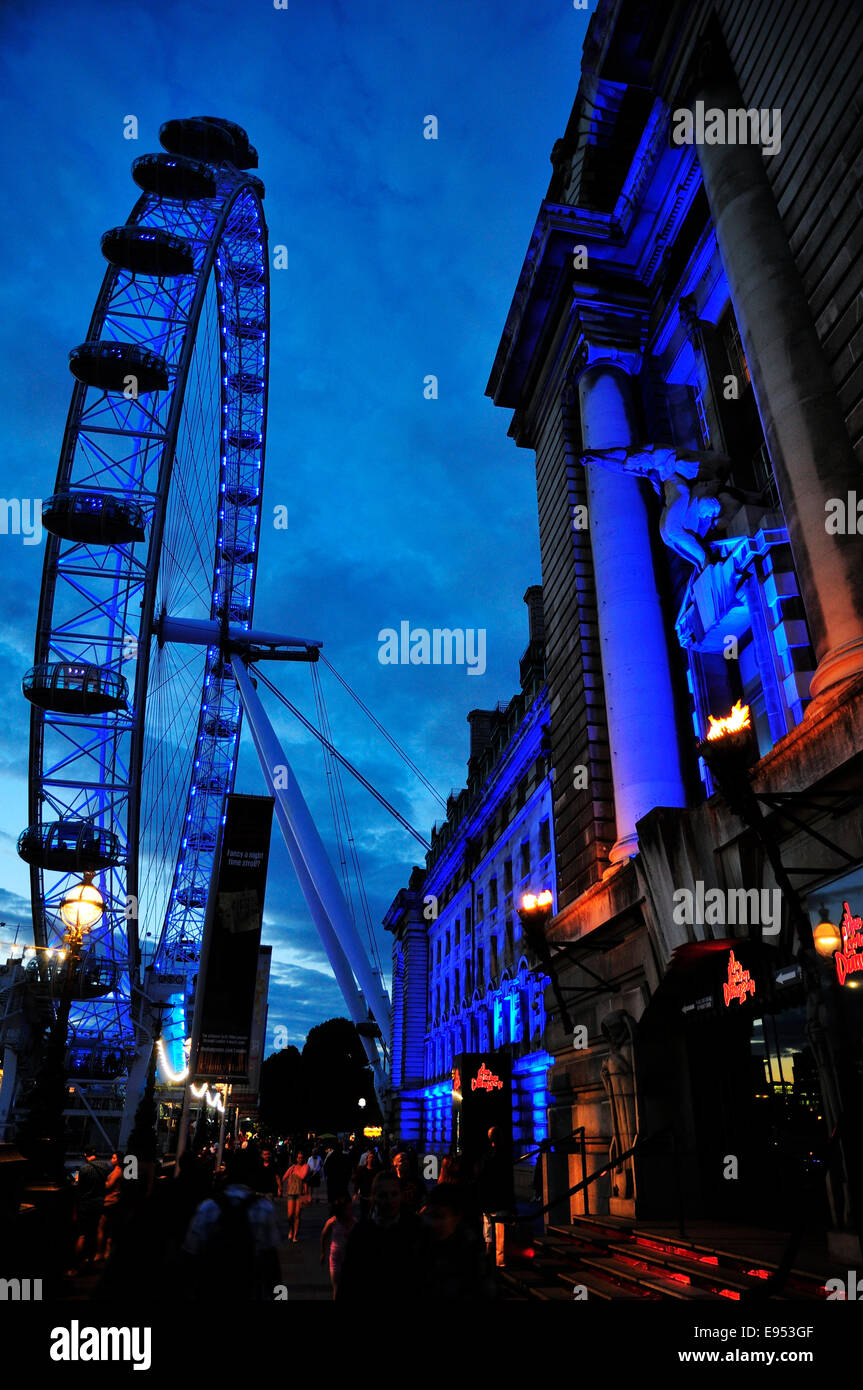 The London Eye at the London County Hall at dusk, London, England, United Kingdom - Stock Image