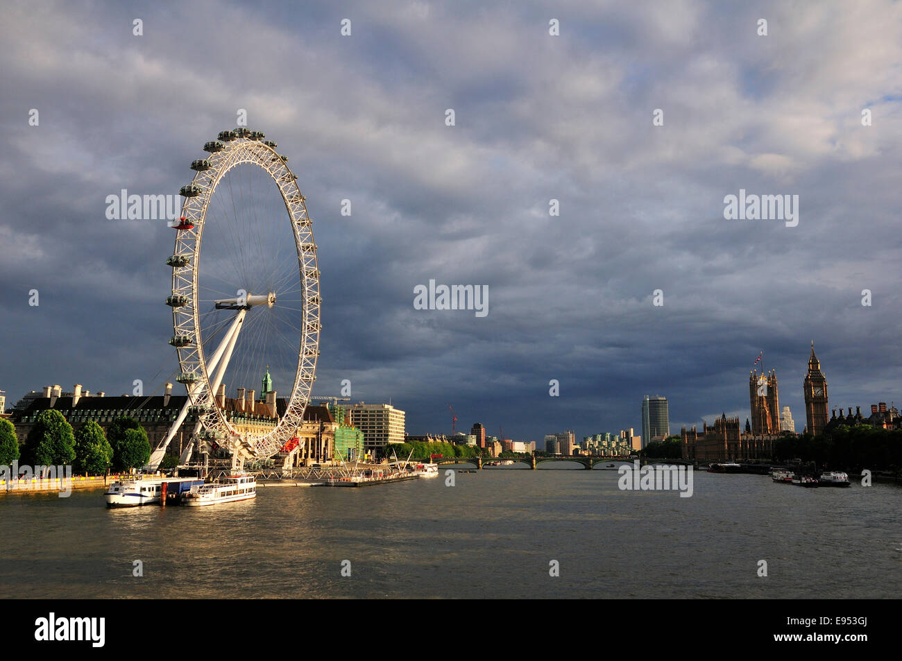 View from the Hungerford Bridge over the River Thames and the London Eye, London, England, United Kingdom - Stock Image