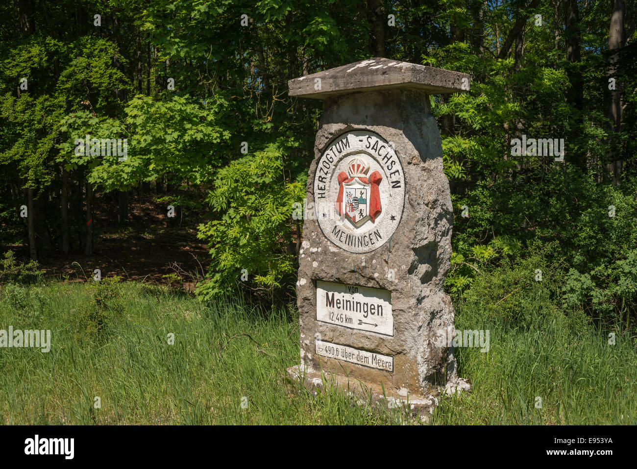 Historic boundary stone with crest of the Duchy of Saxe-Meiningen, now border of Thuringia and Bavaria, Henneberg, - Stock Image