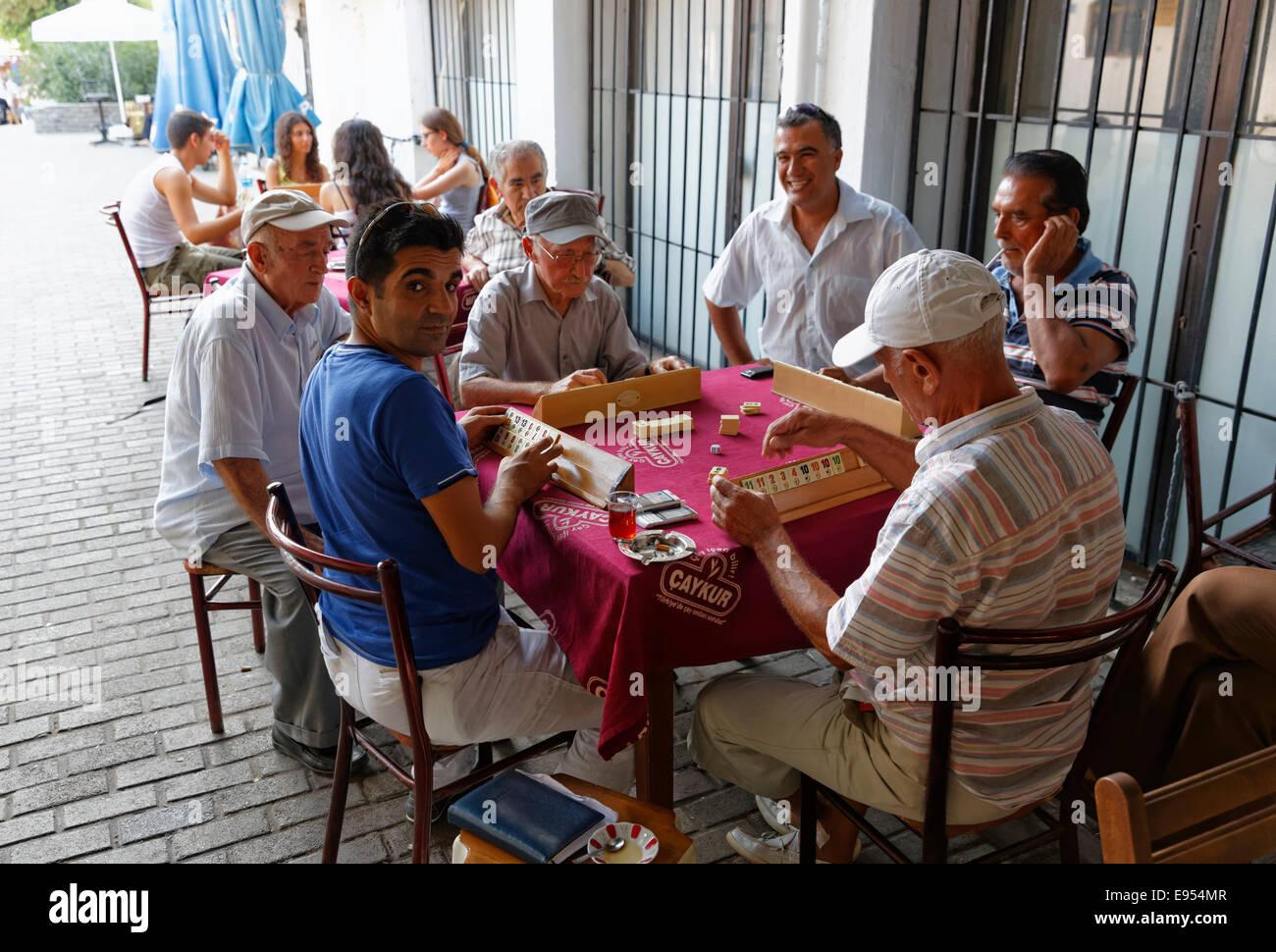 Locals playing the game Okey, Bodrum, Muğla Province, Aegean, Turkey - Stock Image