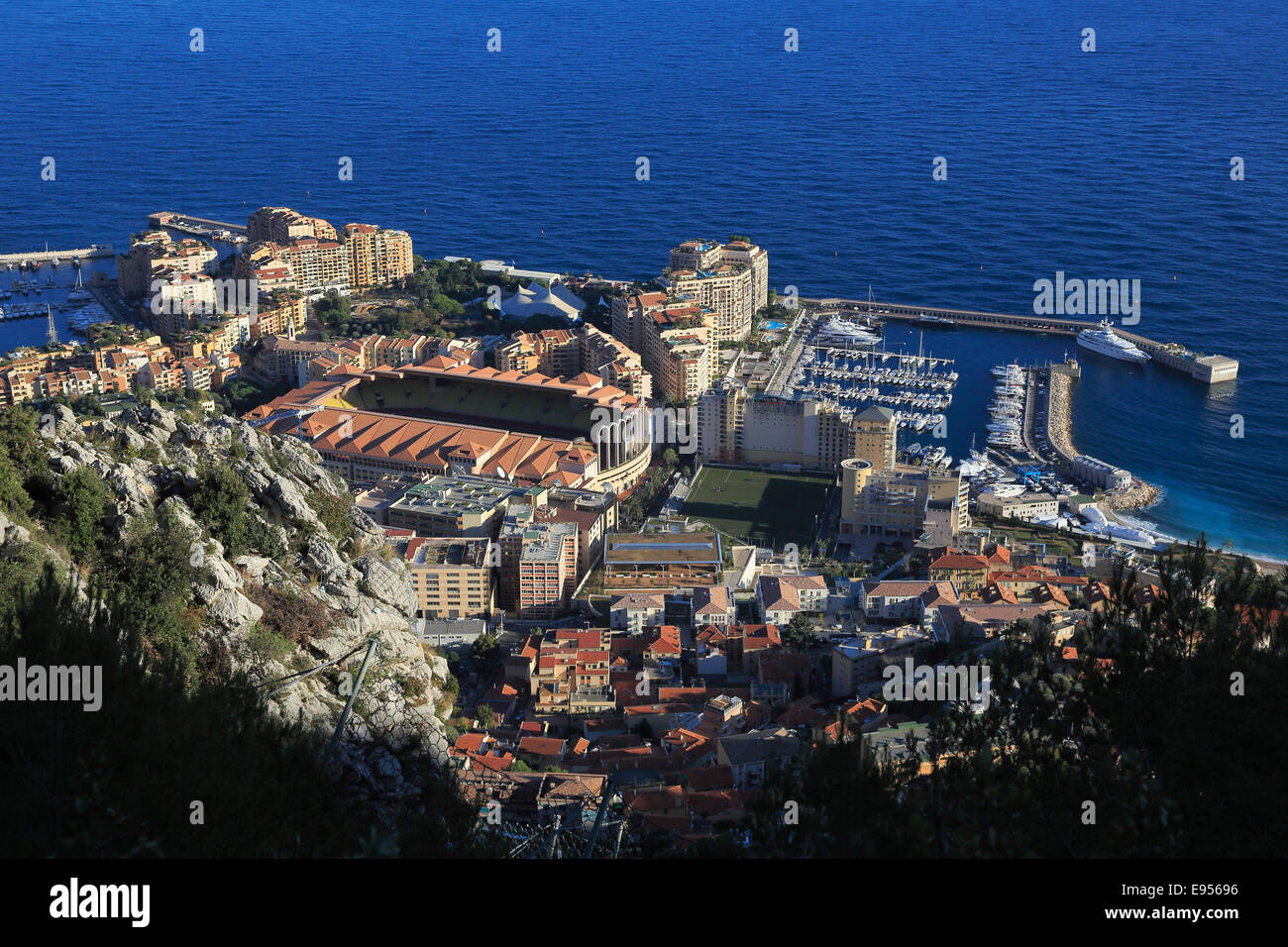 Fontvieille, district built on reclaimed land, with the football stadium and the Port of Cap d'Ail, seen from underneath Stock Photo