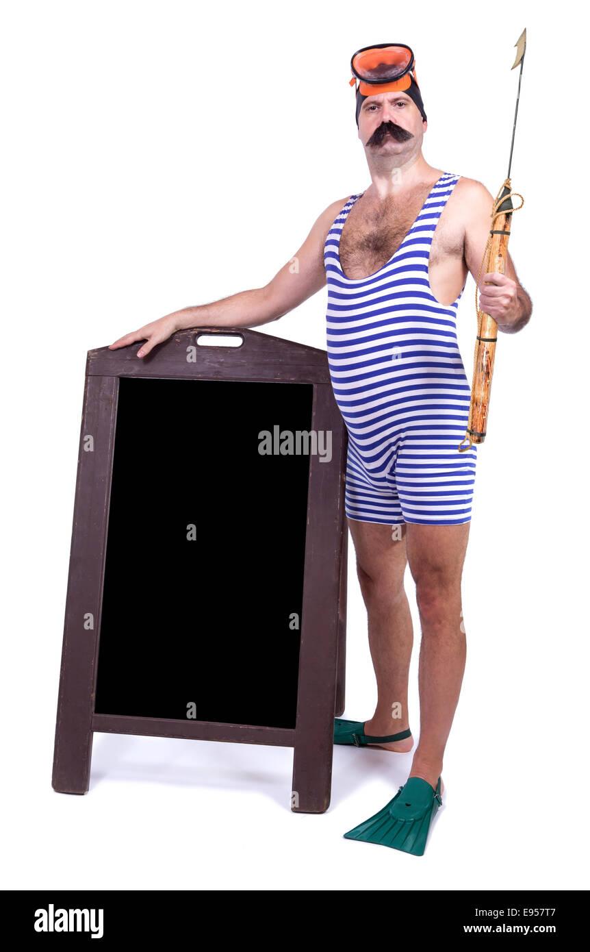 Man in swimsuit standing beside menu - Stock Image