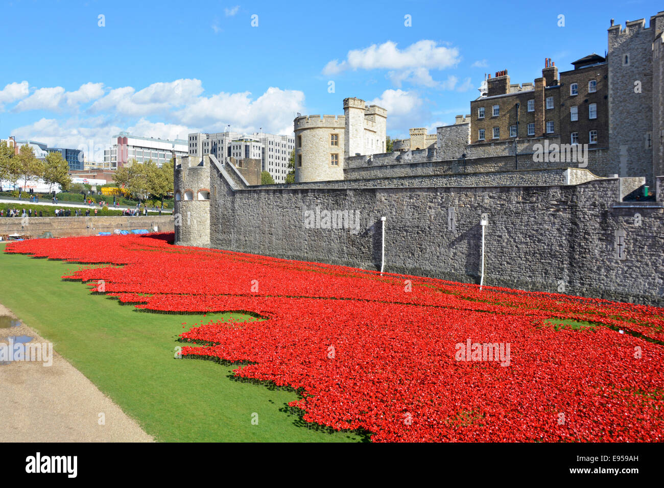 Field of ceramic poppies ('Blood swept lands & seas of red') World War 1 tribute in the dry moat at - Stock Image