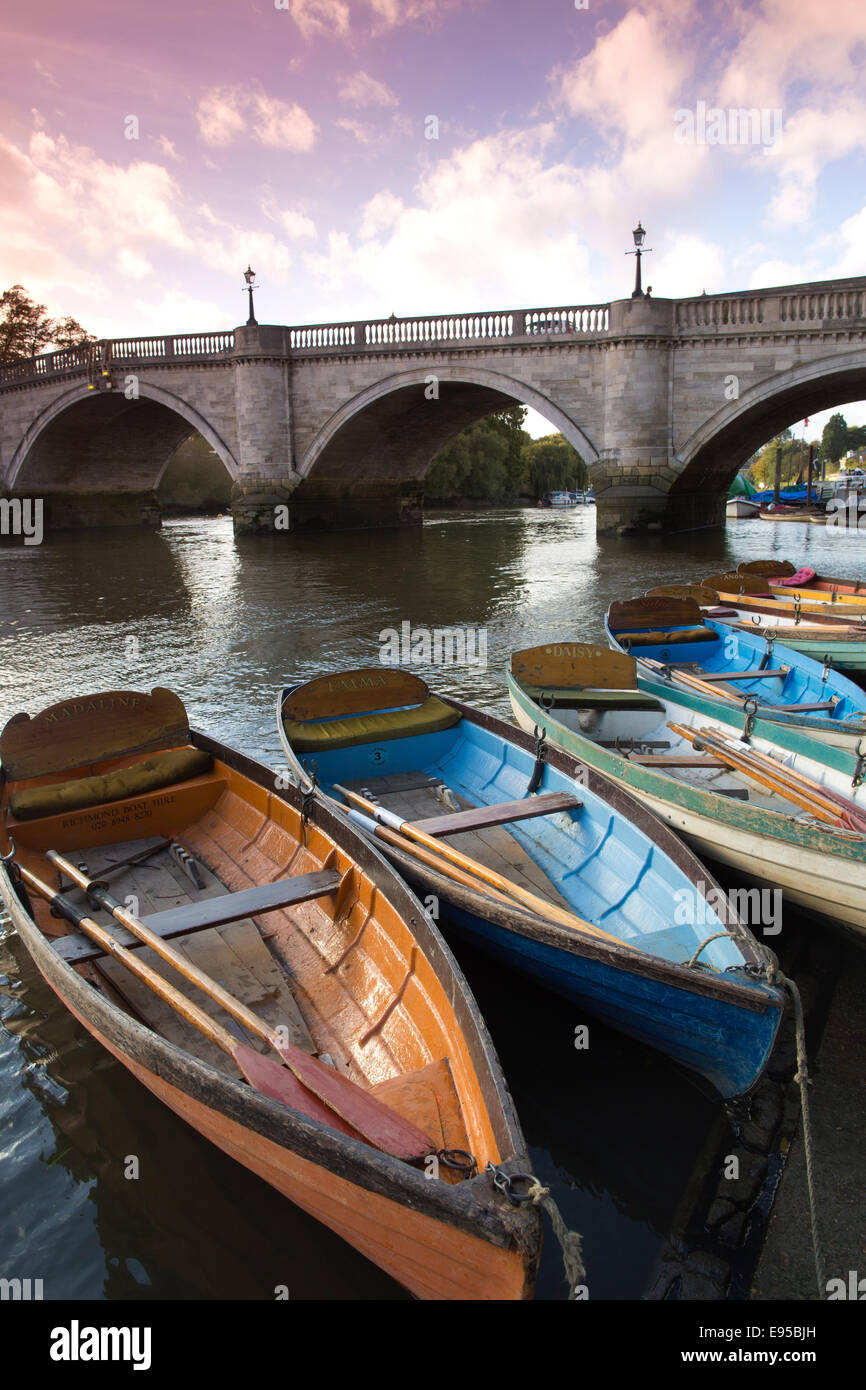 Wooden pleasure boats moored alongside Richmond Bridge on the River Thames, Richmond Upon Thames, Greater London, - Stock Image